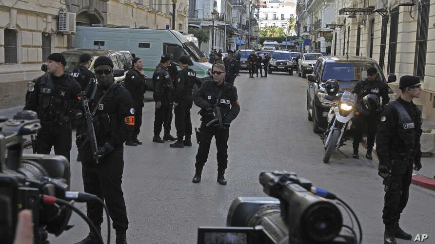 Police forces guard a courthouse in Algiers, Algeria