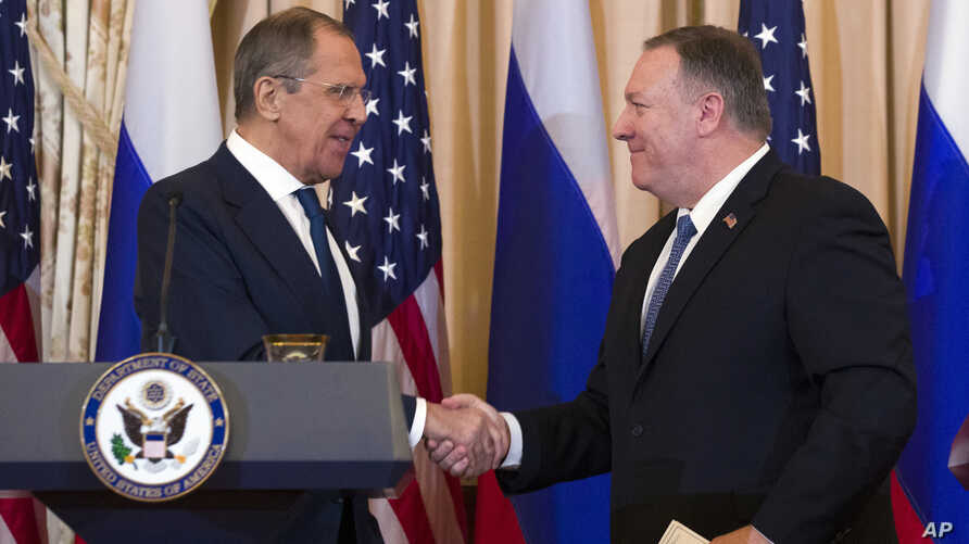 Secretary of State Mike Pompeo, right, shake hands with Russian Foreign Minister Sergey Lavrov, after a media availability at…