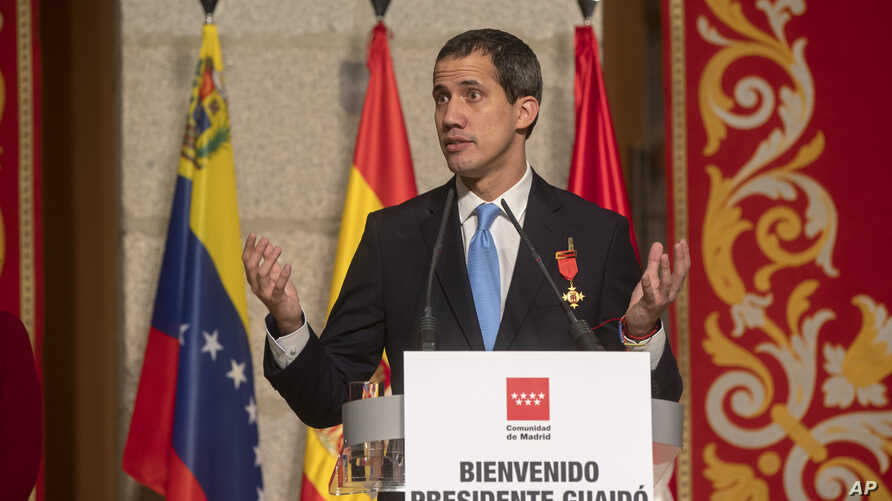 The leader of Venezuela's political opposition Juan Guaido makes a speech at the Madrid regional government building during a visit to Madrid, Spain, Jan. 25, 2020.