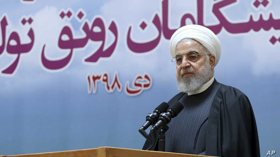 In this photo released by official website of the Office of the Iranian Presidency, President Hassan Rouhani speaks in a…