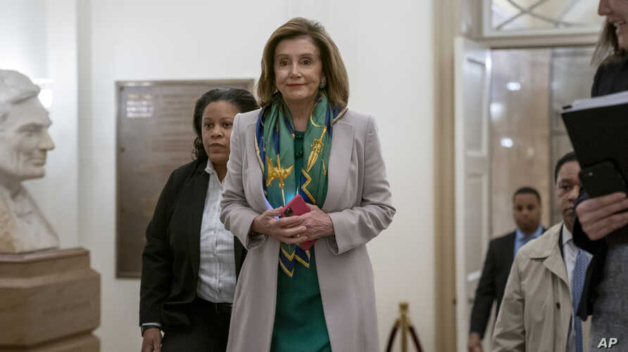 Speaker of the House Nancy Pelosi, D-Calif., arrives to meet with the Democratic Caucus at the Capitol in Washington, Tuesday,…