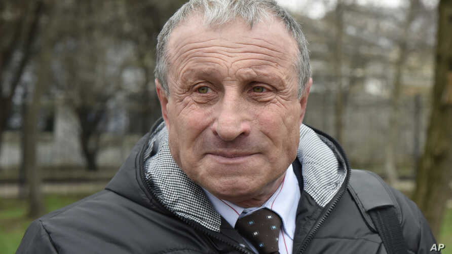 Mykola Semena speaks outside a court in Simferopol, Crimea, Monday, March 20, 2017. The trial gets underway of Crimean…
