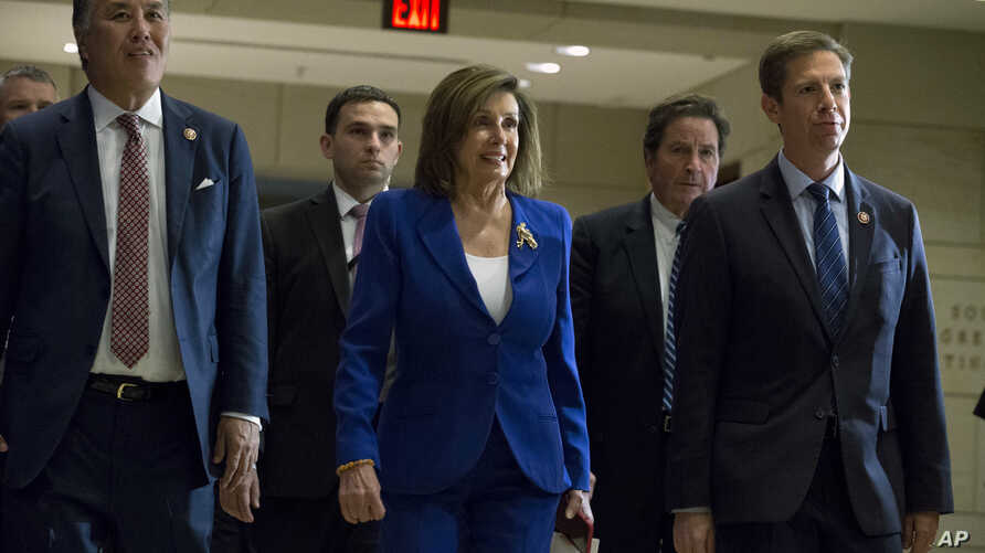Speaker of the House Nancy Pelosi, D-Calif., accompanied by members of the Congress, arrives for a briefing on last week's…