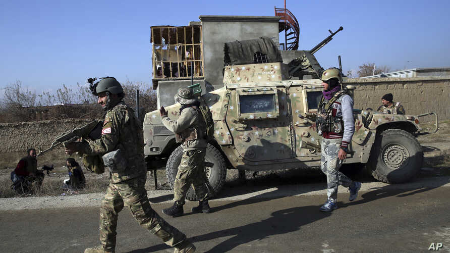 Security personnel arrive near the site of an attack near the Bagram Air Base In Parwan province of Kabul, Afghanistan,…