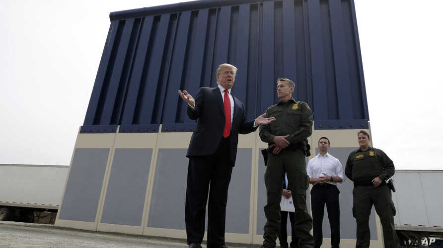 President Donald Trump speaks during a tours as he reviews border wall prototypes, Tuesday, March 13, 2018, in San Diego, as…