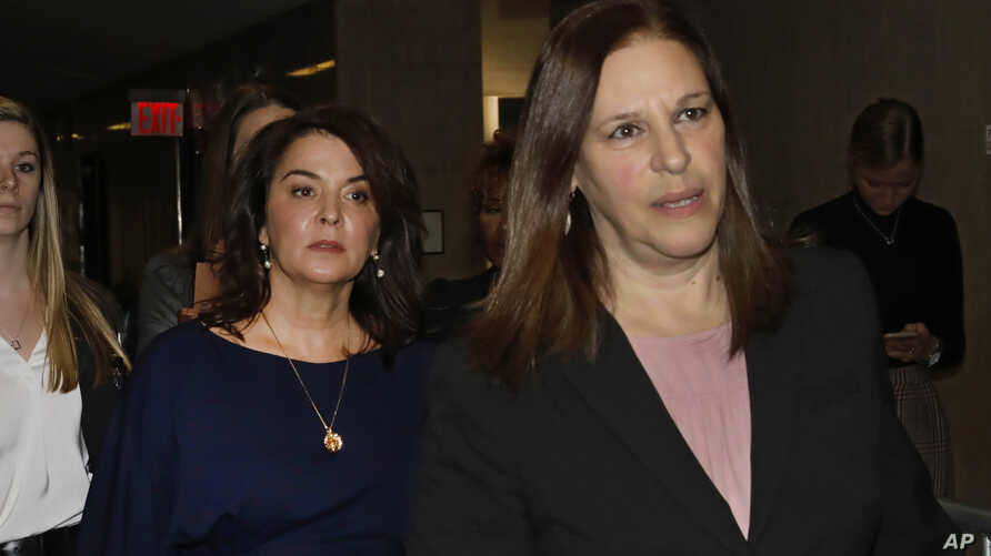 Actress Annabella Sciorra, center, arrives as a witness in Harvey Weinstein's rape trial, with Assistant District Attorney Joan…