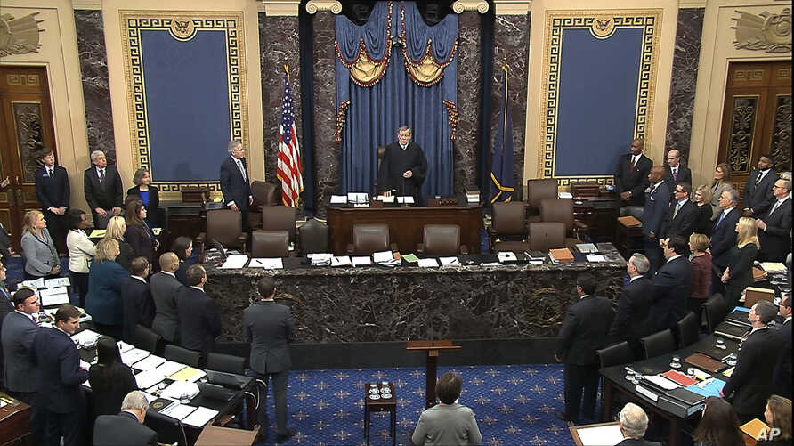 In this image from video, presiding officer Chief Justice of the United States John Roberts arrives for the start of the…