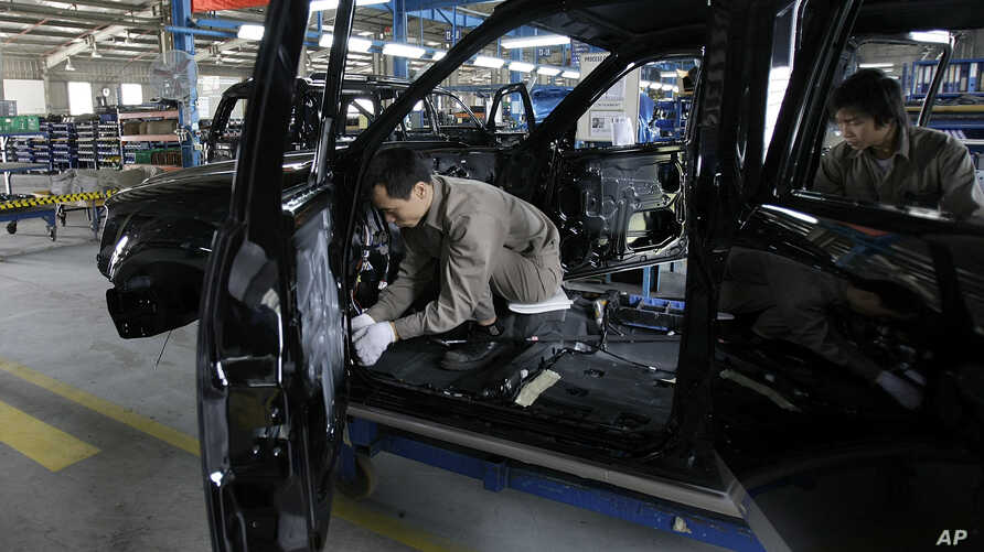 Workers are seen at the Ford  Hai Duong production facility in Hai Duong, Vietnam, 60 kilometers (38 miles)  from Hanoi, …