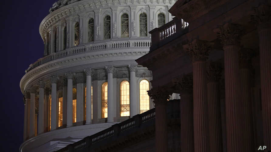 Light shines on the U.S. Capitol dome before a House Judiciary Committee markup of the articles of impeachment against…