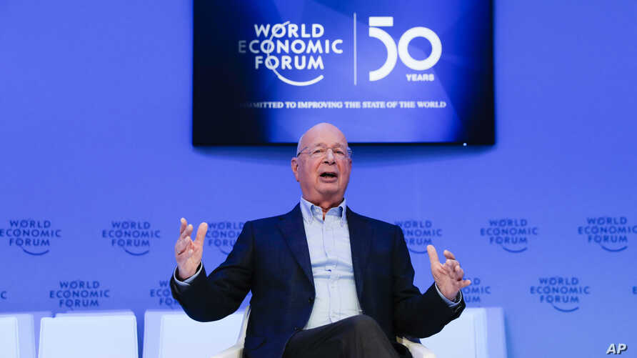 Klaus Schwab, founder and Executive Chairman of the World Economic Forum poses for a photo after an interview with the…