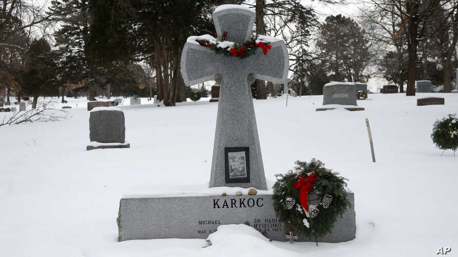 A wreath adorns a headstone for Michael Karkoc at Hillside Cemetery, Tuesday, Jan. 21, 2020, in Minneapolis. Karkoc, a retired…