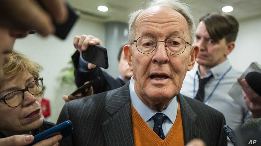 Sen. Lamar Alexander, R-Tenn., speaks to reporters as he arrives at the Capitol in Washington, Monday, Jan. 27, 2020, during…