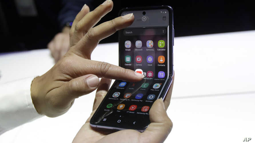 A Samsung worker gives a demonstration of the Galaxy Z Flip Phone at the Unpacked 2020 event in San Francisco, Tuesday, Feb. 11…