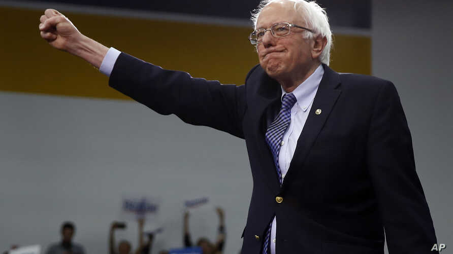 Democratic presidential candidate Sen. Bernie Sanders, I-Vt., arrives to speak to supporters at a primary night election rally…