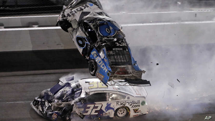 Ryan Newman (6) goes airborne after crashing with Corey LaJoie (32) during the NASCAR Daytona 500 auto race Monday, Feb. 17,…