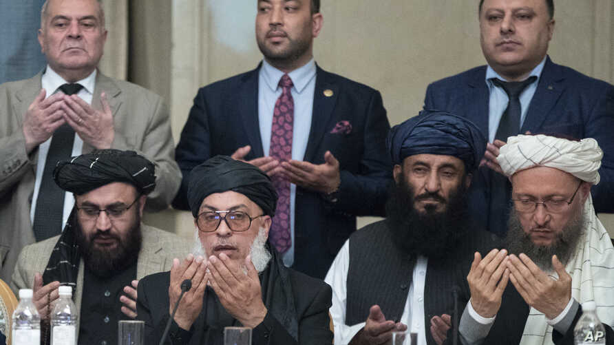 Taliban political chief Sher Mohammad Abbas Stanikzai, first row second from left, Abdul Salam Hanafi and other Taliban…