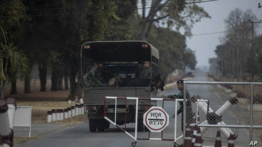 A truck with soldiers and sniffer dogs enter Thai army's 22nd Ammunition Battalion in Surathampitak Military Camp, where a Thai…