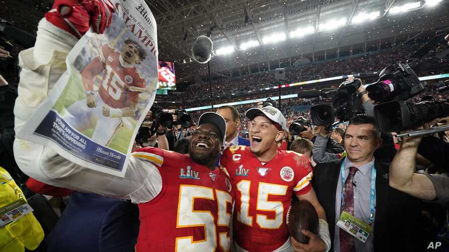 Kansas City Chiefs' Frank Clark, left, and Patrick Mahomes celebrate after defeating the San Francisco 49ers in the NFL Super…