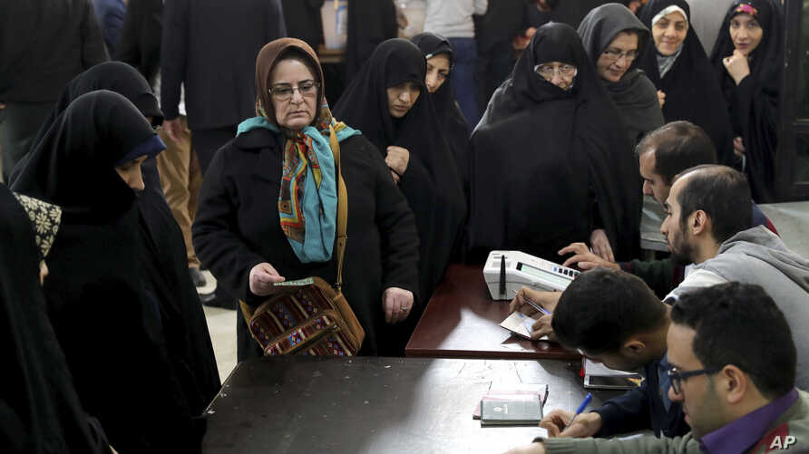 Iranians queue for voting in the parliamentary elections in a polling station in Tehran, Iran, Friday, Feb. 21, 2020. Iranians…