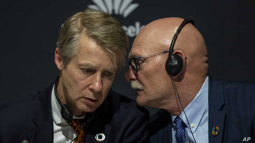 Director general of the GSMA Mats Granryd, left, and CEO and Director for GSMA Ltd. John Hoffman take part in a press…