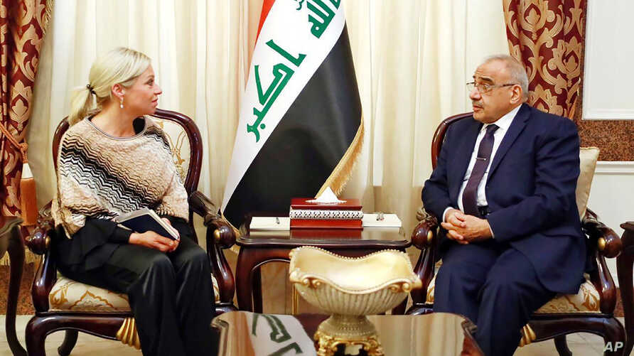 A photo released by the Iraqi Prime Minister Media Office, shows Iraqi acting Prime Minister Adil Abdul-Mahdi meeting with the…