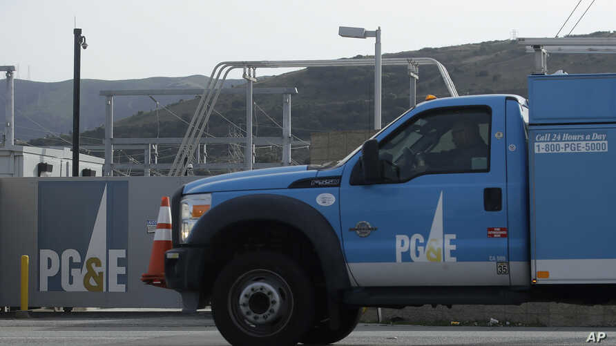 A Pacific Gas and Electric truck drives past a PG&E location in San Francisco, Thursday, Feb. 20, 2020. (AP Photo/Jeff Chiu)