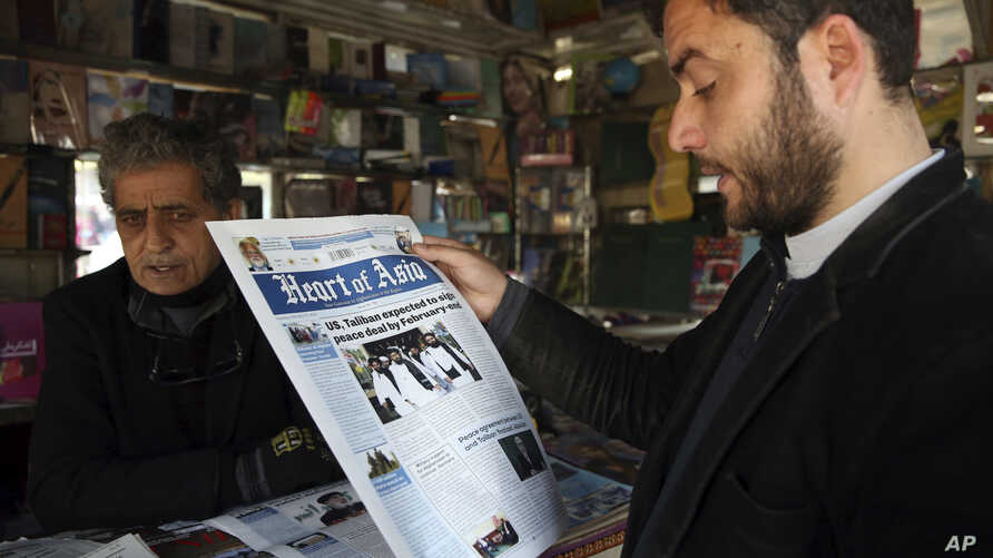 A man reads a newspaper about peace talks in Kabul, Afghanistan. Saturday, Feb. 22, 2020. A temporary truce between the United…