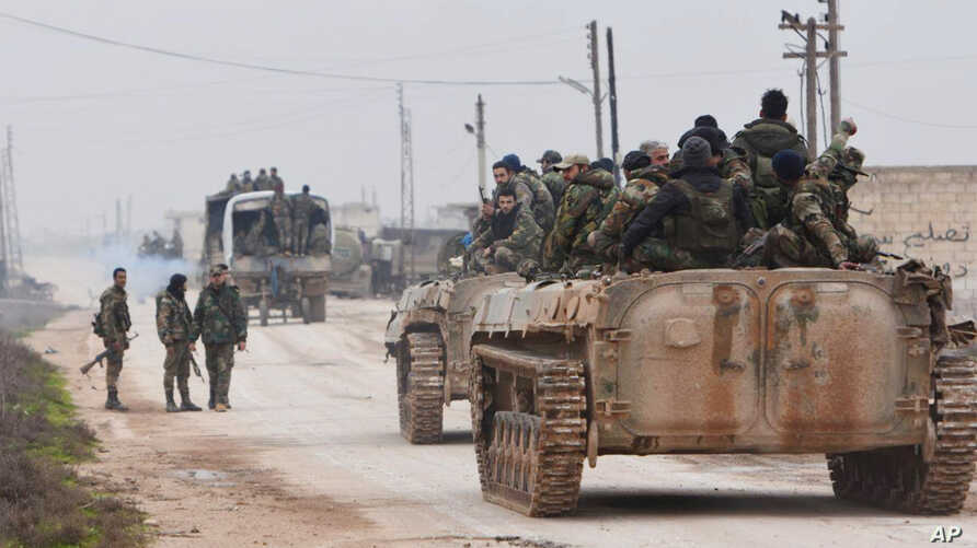 In this photo released by the Syrian official news agency SANA, shows government forces entering the village of Tel-Toukan, in Idlib province, northwest Syria, Feb. 5, 2020.