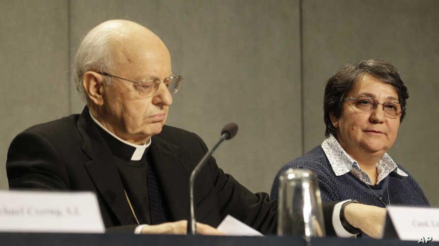 Cardinal Lorenzo Baldisseri and Sister Augusta de Oliveira attend a press conference presenting the post-synodal apostolic…