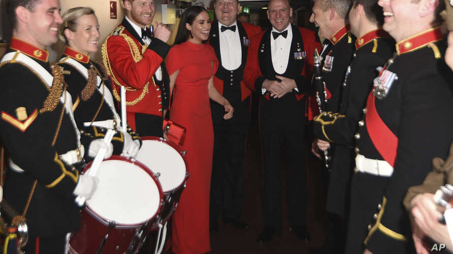Britain's Prince Harry and Meghan, Duchess of Sussex, alongside the Massed Bands of Her Majesty's Royal Marines attend the…