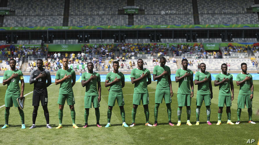 FILE - In this Saturday Aug. 20, 2016 file photo, Nigeria's soccer team sing the national anthem before the bronze medal match…
