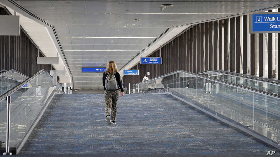 A concourse at Sky Harbor Airport is unusually empty as airlines cut flights due to the coronavirus outbreak, Tuesday, March 17…