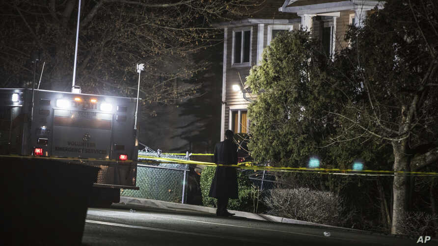 An Orthodox Jewish man stands in front of a residence in Monsey, N.Y., Sunday, Dec. 29, 2019, following a stabbing late…