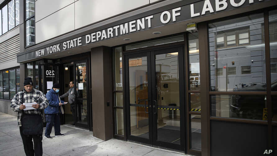 Visitors to the Department of Labor are turned away at the door by personnel due to closures over coronavirus concerns,…