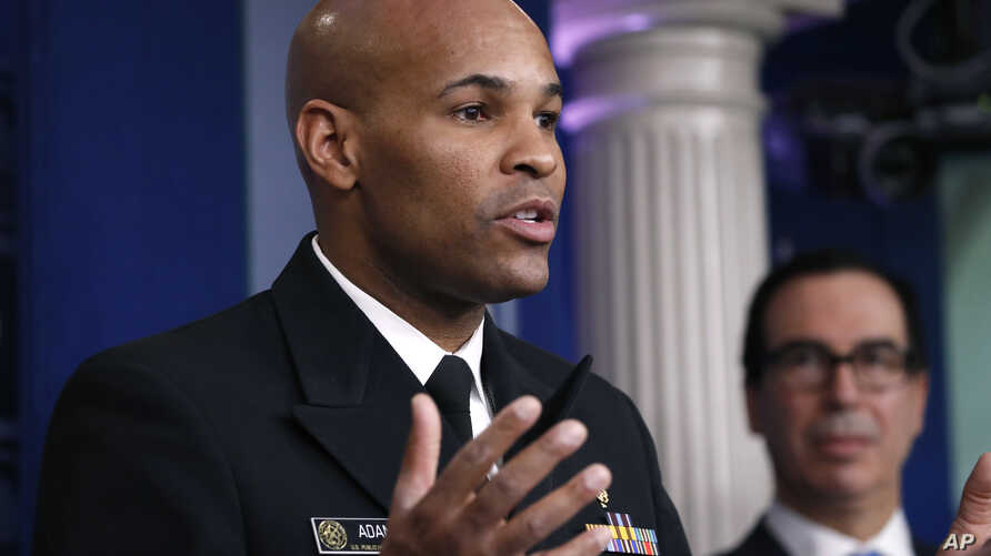 U.S. Surgeon General Jerome Adams speaks during a briefing on coronavirus in the Brady press briefing room at the White House,…