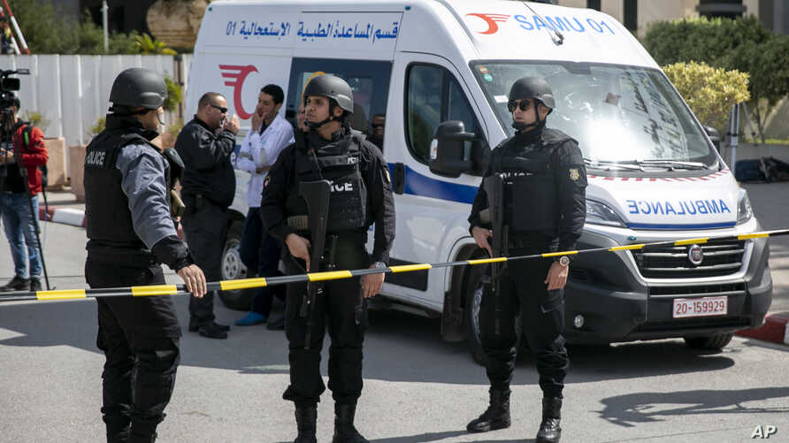 Police officers guard the blast site near the US Embassy in Tunis, Friday, March 6, 2020. Tunisian media are reporting that two…