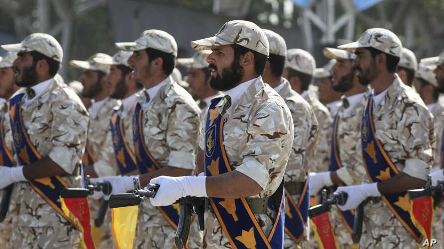 In this Sept. 22, 2011 photo, members of Iran's Revolutionary Guard march in front of the mausoleum of the late Iranian…
