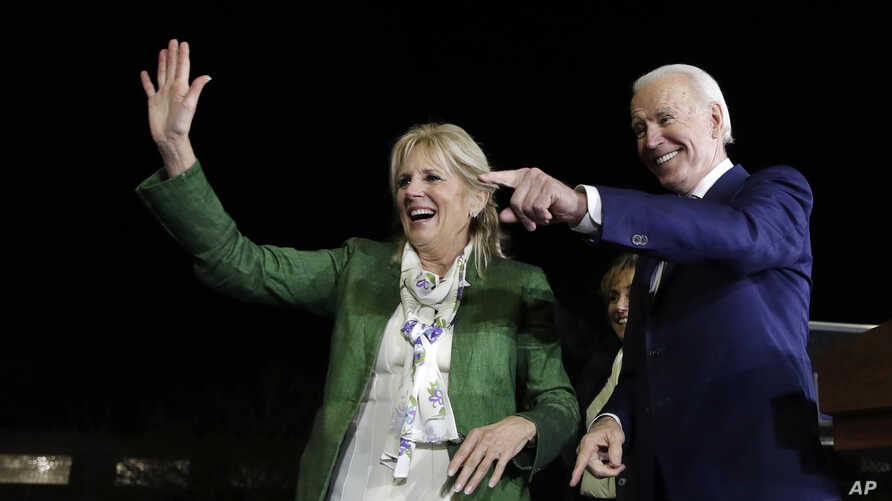 Democratic presidential candidate former Vice President Joe Biden, right, and his wife Jill attend a primary election night…