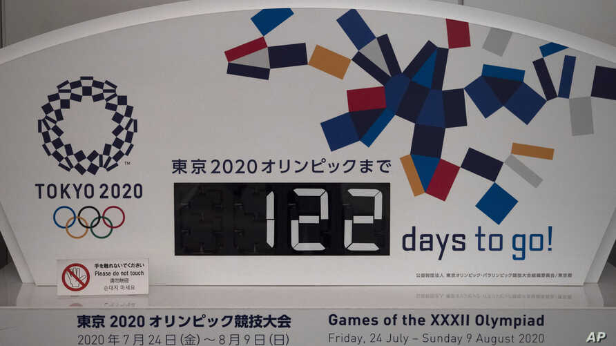 A countdown display for the Tokyo 2020 Olympics is photographed in Tokyo, Tuesday, March 24, 2020. IOC President Thomas Bach…
