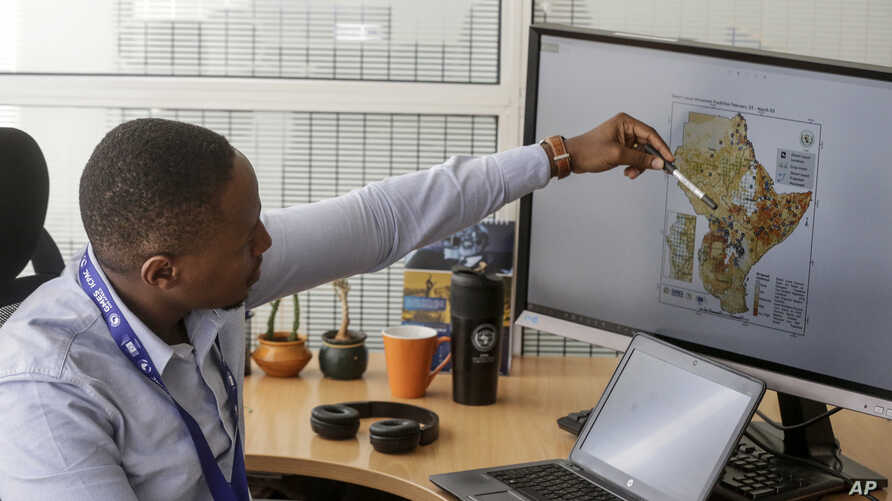 In this photo taken on Thursday, March 5, 2020, Kenneth Mwangi, a satellite information analyst at the Intergovernmental…