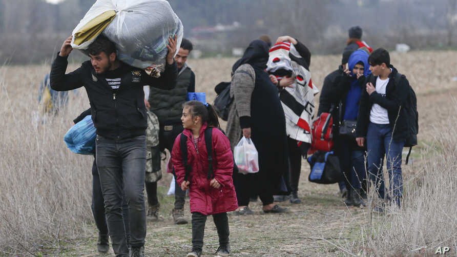 Migrants walk near Pazarkule at the Turkish-Greek border on Thursday, March 5, 2020. Turkey has vowed to seek justice for a…
