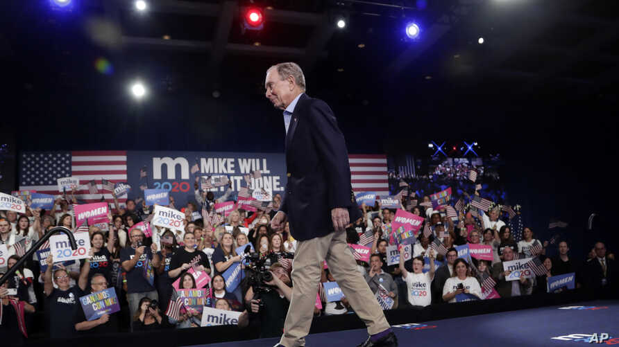Democratic presidential candidate former New York City Mayor Mike Bloomberg walks off stage after speaking during a rally,…