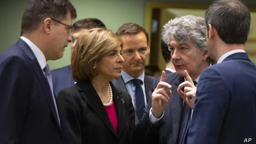European Commissioner for Internal Market Thierry Breton, second right, speaks with European Commissioner for Crisis Management…