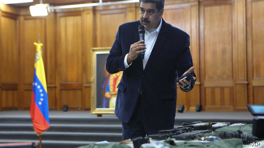 This photo released by the Venezuelan Miraflores presidential press office shows President Nicolas Maduro speaking over…