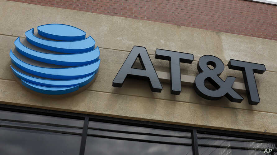 This is the sign on an AT&T store in Pittsburgh, Pa., Tuesday, April 14, 2020. (AP Photo/Gene J. Puskar)