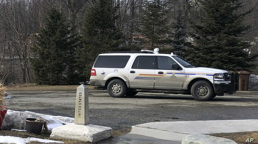 An Royal Canadian Mounted Police cruiser sits in Quebec, Canada, across the border from the United States, Wednesday, March 18,…
