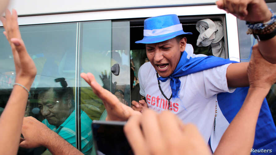 A political prisoner,who according to local media was arrested for participating in a protest against Nicaraguan President Daniel Ortega's government, shouts slogans after being released from La Modelo Prison, in Masaya, June 11, 2019.
