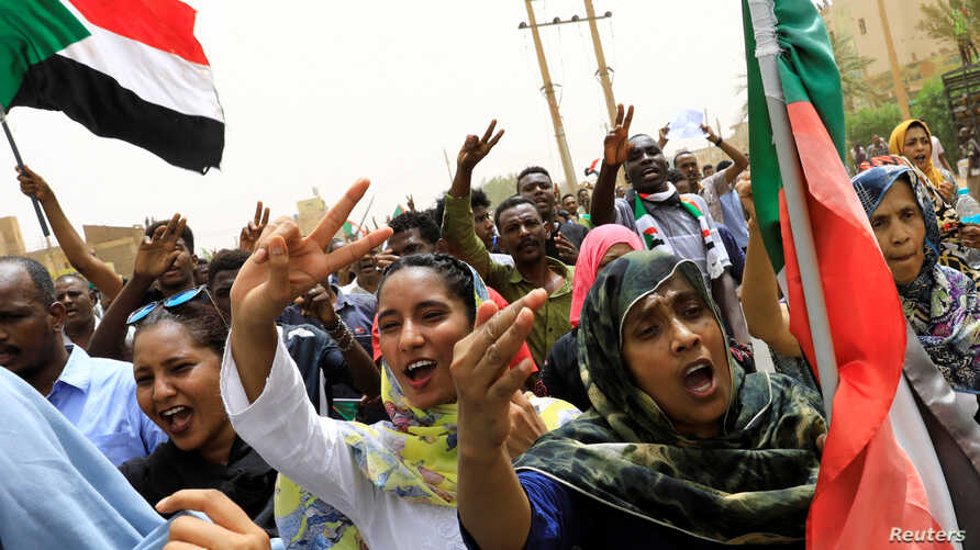 People shout slogans as they march on the streets demanding the ruling military hand over to civilians during a demonstration in Khartoum, Sudan, June 30, 2019.