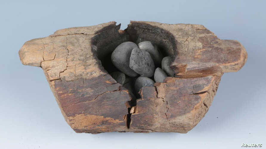 Wooden brazier and burnt stones from an archaeological site in western China
