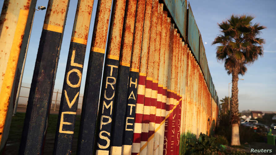 A message and the colors of the U.S. flag are seen on the U.S. and Mexico border fence at Friendship Park in Tijuana.